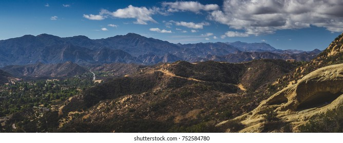 Beautiful panoramic overlook of Red Rock Canyon and rock formations on a sunny day with blue sky and clouds, Red Rock Canyon Park, Topanga, California
