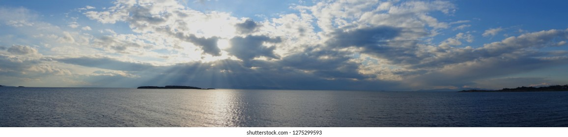 Beautiful panoramic photo of nice clouds over the Aegean sea and Cyclades islands
