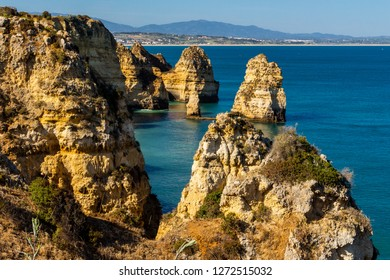 Beautiful panoramic sea view over rocks and cliffs in the Atlantic Ocean at Ponta da Piedade, Algarve region, Portugal