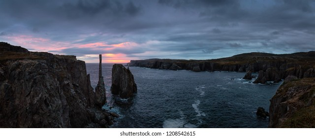 Beautiful panoramic seascape of a rocky Atlantic Ocean Coast during a cloudy sunrise. Taken in Spillars Cove, Bonavista, Newfoundland and Labrador, Canada.