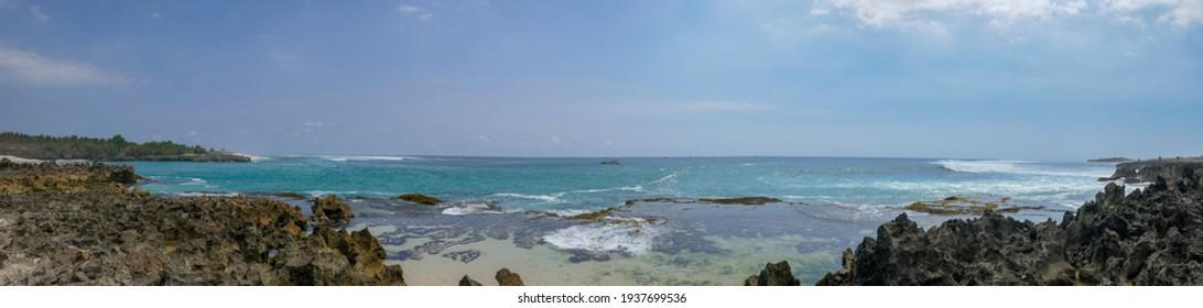 Beautiful panoramic seascape of rocky coastline at Pero fishing village on Sumba island, East Nusa Tenggara, Indonesia - Shutterstock ID 1937699536