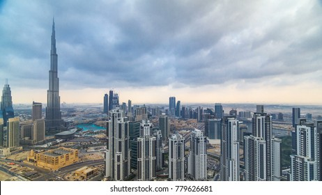 Beautiful panoramic skyline of Dubai timelapse, United Arab Emirates. View of world famous skyscrapers. Aerial top view from tower rooftop. Beautiful cloudy sky. Colourful travel and business