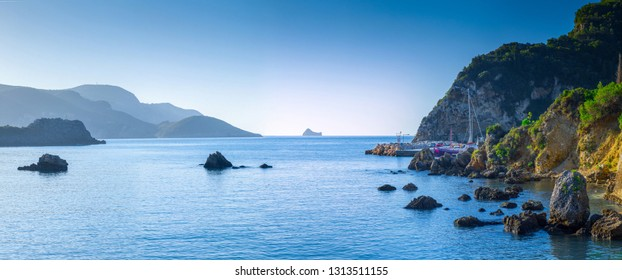 Beautiful panoramic summer seascape. View of the coastline into the sea bays with crystal clear azure water. Mediterranean sea, somewhere in Europe