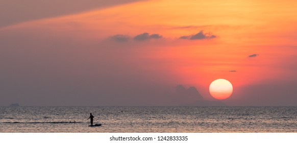 Beautiful panoramic  tropical beach sunset with golden lights background,Koh Samui Thailand