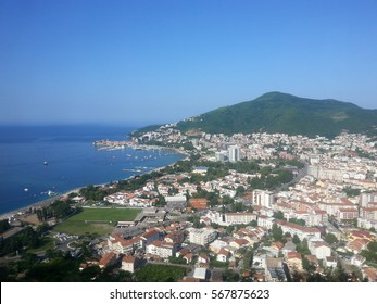 Beautiful panoramic view of the Adriatic sea and the mountains and the city on a sunny warm day. Somewhere in Montenegro.