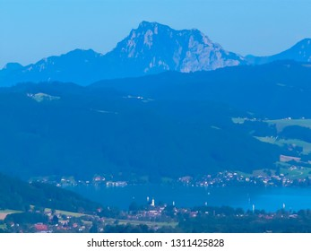 Beautiful panoramic view of Alps and blue Attersee in Austria near Salzburg from the Lichtenberg viewpoint wooden tower in Attergauer. Summer day hiking in Alps mountains in Austria near German border