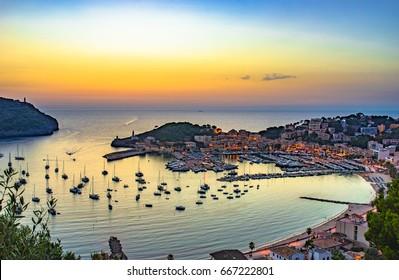 Beautiful panoramic view of the bay harbor of Port de Soller at sunset, Majorca island, Spain.