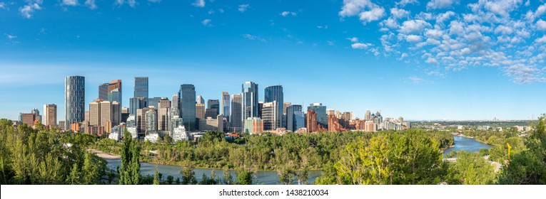 Beautiful panoramic view of Calgary's skyline on a bright blue sky day.