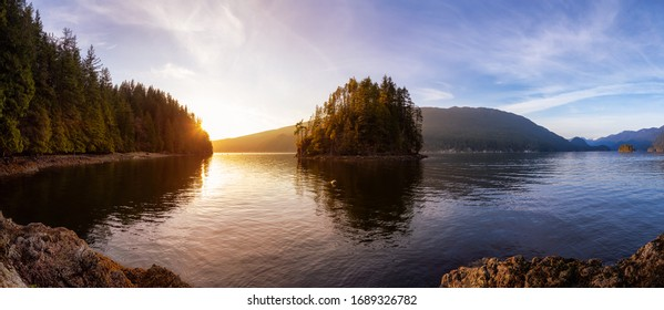 Beautiful Panoramic View of the Canadian Landscape during a vibrant winter sunset. Hike on Jug Island Trail in Belcarra, Vancouver, British Columbia, Canada. Nature Panorama Background