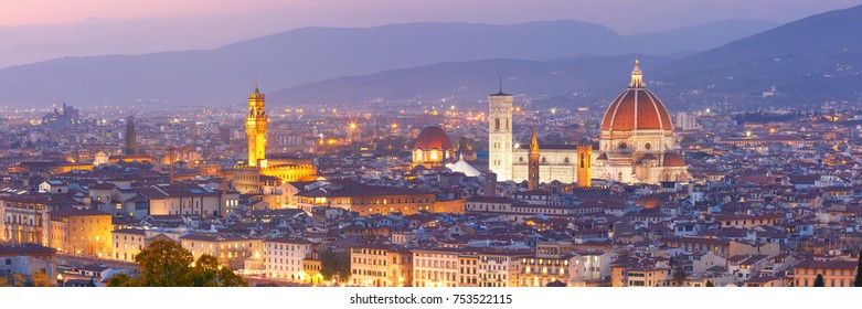 Beautiful panoramic view of Duomo Santa Maria Del Fiore and tower of Palazzo Vecchio during evening blue hour in Florence, Tuscany, Italy