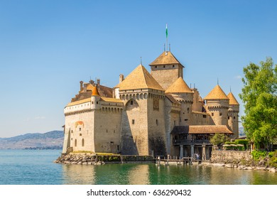 Beautiful Panoramic View of Famous Chateau de Chillon at Lake Geneva, one of Switzerland's Tourist Attractions and Most visited Castles in Europe with Blue Sky and Clouds, Canton of Vaud, Switzerland