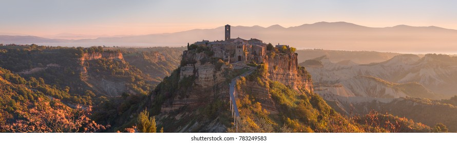 Beautiful panoramic view of famous Civita di Bagnoregio with Tiber river valley at sunset, Lazio, Italy