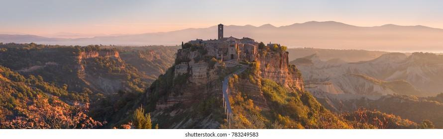 Beautiful panoramic view of famous Civita di Bagnoregio with Tiber river valley at sunset, Lazio, Italy