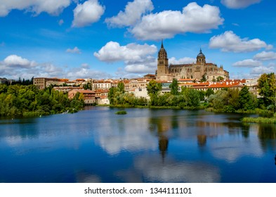 Beautiful panoramic view of the historic city of Salamanca with Rio Tormes and New Cathedral from Enrique Esteban bridge in  spring