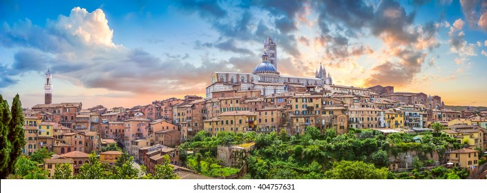 Beautiful panoramic view of the historic city of Siena at sunset with an amazing cloudscape on an idyllic summer evening, Tuscany, Italy