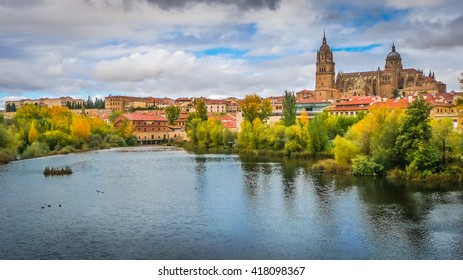 Beautiful panoramic view of the historic city of Salamanca with Rio Tormes and New Cathedral from Enrique Esteban bridge in autumn, Castilla y Leon region, Spain
