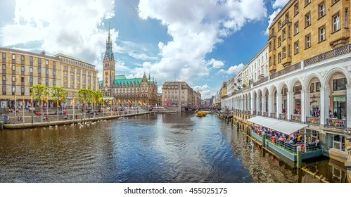 Beautiful panoramic view of historic Hamburg city center with famous town hall and Alster river on a sunny day with blue sky in summer, Germany