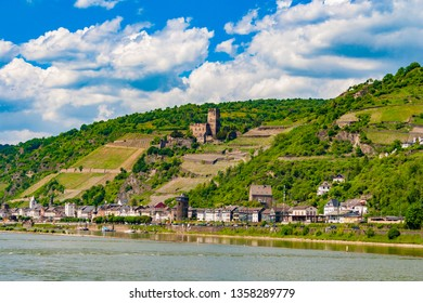 Beautiful panoramic view of Kaub, a town located on the right bank of the Rhine River and Gutenfels Castle in the background; on a nice sunny day with a blue sky. The area is part of the Rhine Gorge.