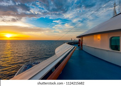 Beautiful panoramic view of the landscape with sunrise from the deck of a passenger cruise ship