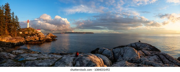 Beautiful panoramic view of a Lighthouse on a rocky coast during a cloudy sunset. Taken in Horseshoe Bay, West Vancouver, British Columbia, Canada.