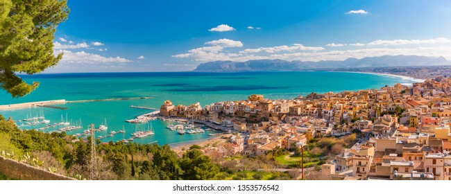 Beautiful panoramic view of medieval fortress in Cala Marina, harbor in coastal city Castellammare del Golfo in the morning, Sicily, Italy