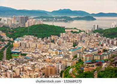 Beautiful Panoramic view of the resort city, China, Hainan. Town Sanya is popular tourist destination in China. Residential area of city Sanya, ashore South China Sea