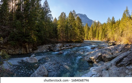 Beautiful Panoramic View of the river in the Canadian Mountain Landscape during a sunny winter day. Taken in Golden Ears Provincial Park, near Vancouver, British Columbia, Canada.
