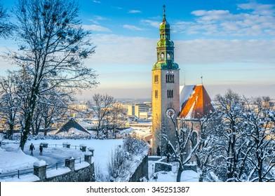 Beautiful panoramic view of Salzburg skyline with Muellner Church and river Salzach in winter, Salzburger Land, Austria