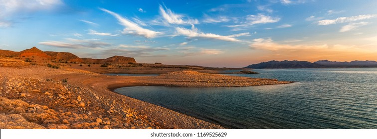 Beautiful panoramic view from the shores of the Lake Mead National Recreation Area at dusk, Nevada, summer.