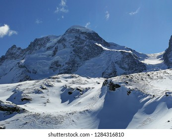 Beautiful panoramic view of snow-capped mountains with ski slopes in the Swiss Alps near Zermatt, in canton of Wallis, Switzerland