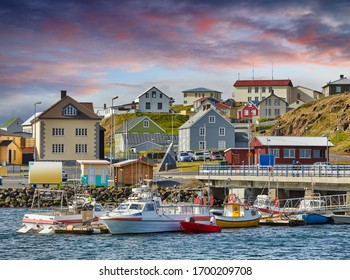 Beautiful panoramic view of the Stykkisholmskirkja Harbor with Fishing ships (boats) at Stykkisholmur town in western Iceland. City view from Sugandisey Cliff with lighthouse. Famous colorful houses