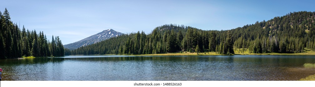 A beautiful panoramic view of Todd Lake with Mt. Bachelor in the distance near Bend, Oregon in the Deschutes National Forest.