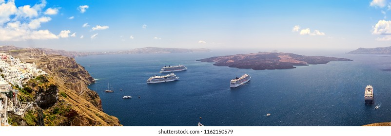 Beautiful panoramic view from touristic Fira town to caldera and volcano and cruise ship at summer sunny day. Santorini Island, Thira, Greece.