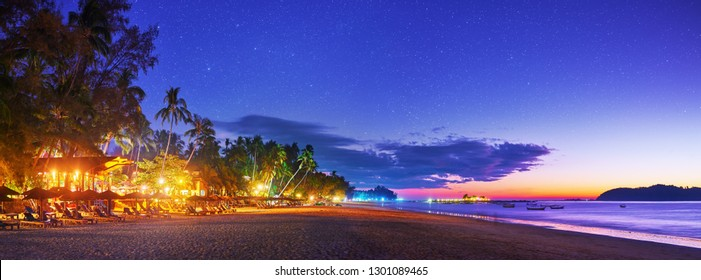 Beautiful panoramic view of a tropical beach at sunset on the resort coast in Ngapali, Myanmar.