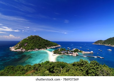 Beautiful panoramic view of tropical island against blue sky with clouds. Full moon music party island. Tropical paradise in Thailand. Nang yuan island.