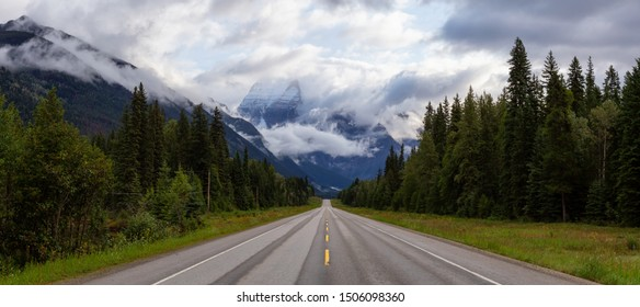 Beautiful Panoramic View of Yellowhead Highway with Mount Robson in the background during a cloudy summer morning. Taken in British Columbia, Canada.