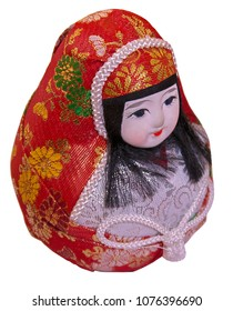 Beautiful paper mache Daruma doll in female form. Roly-poly toy - Japanese gift for success & good luck. Isolated. Selective focus.