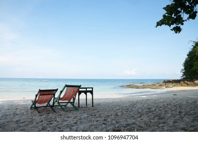 Beautiful paradise island with chair on the beach and sea - Holiday Vacation concept