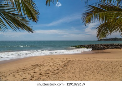 Beautiful paradise sea view with footsteps on a beach in Tangalle, Sri Lanka