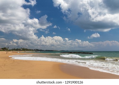 Beautiful paradise view on a coast with deep blue sky and clouds on a sunny day, Tangalle, Sri Lanka