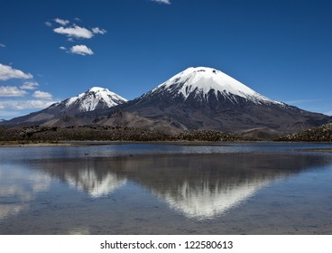Beautiful Parinacota volcano with Chungar�¡ lake in Nacional Parque Lauca, Chile