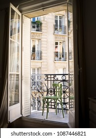 Beautiful Parisian balcony with a green chair, France