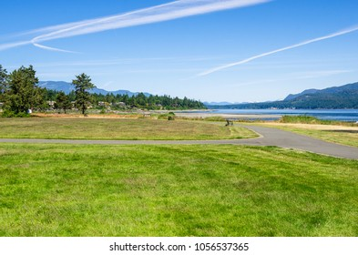 Beautiful Park by the Ocean overlooking the Discovery Passage in Campbell River, BC, Canada, on a Sunny Summer Morning.