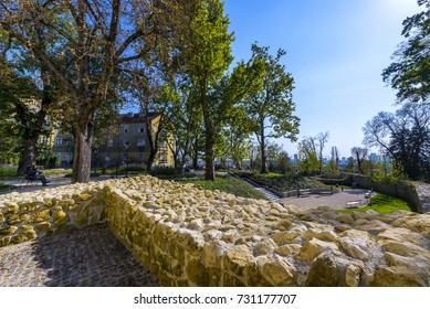 Beautiful park on Upper Town Zagreb, Croatia, with ancient walls and tall trees.