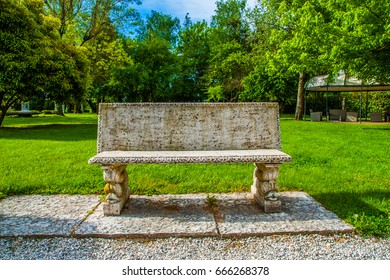 Beautiful park with a stone bench in a small town in Tuscany