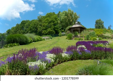 beautiful parkway with many different flowerbeds and pavillon on a sunny summer day - Austria