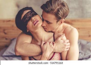 Beautiful passionate couple is having sex on bed