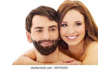 Beautiful passionate shirtless couple embracing.