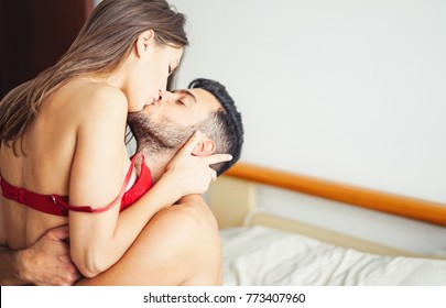 Beautiful passionate young couple having sex on the bed at home - Intimate and sensual moments of a couple kissing in the bedroom - Relationship, intimate, love concept