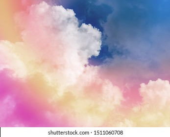 Beautiful pastel color with rainbow shade on white fluffy clouds, colorful blue sky on background, upward view and copy space image